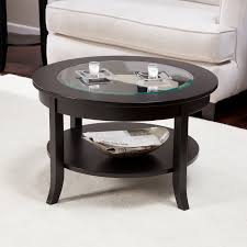 Round Black Coffee Table Small Candle Glasses Newspaper Bowl White Carpet White Sofa Full Version (Image 5 of 10)