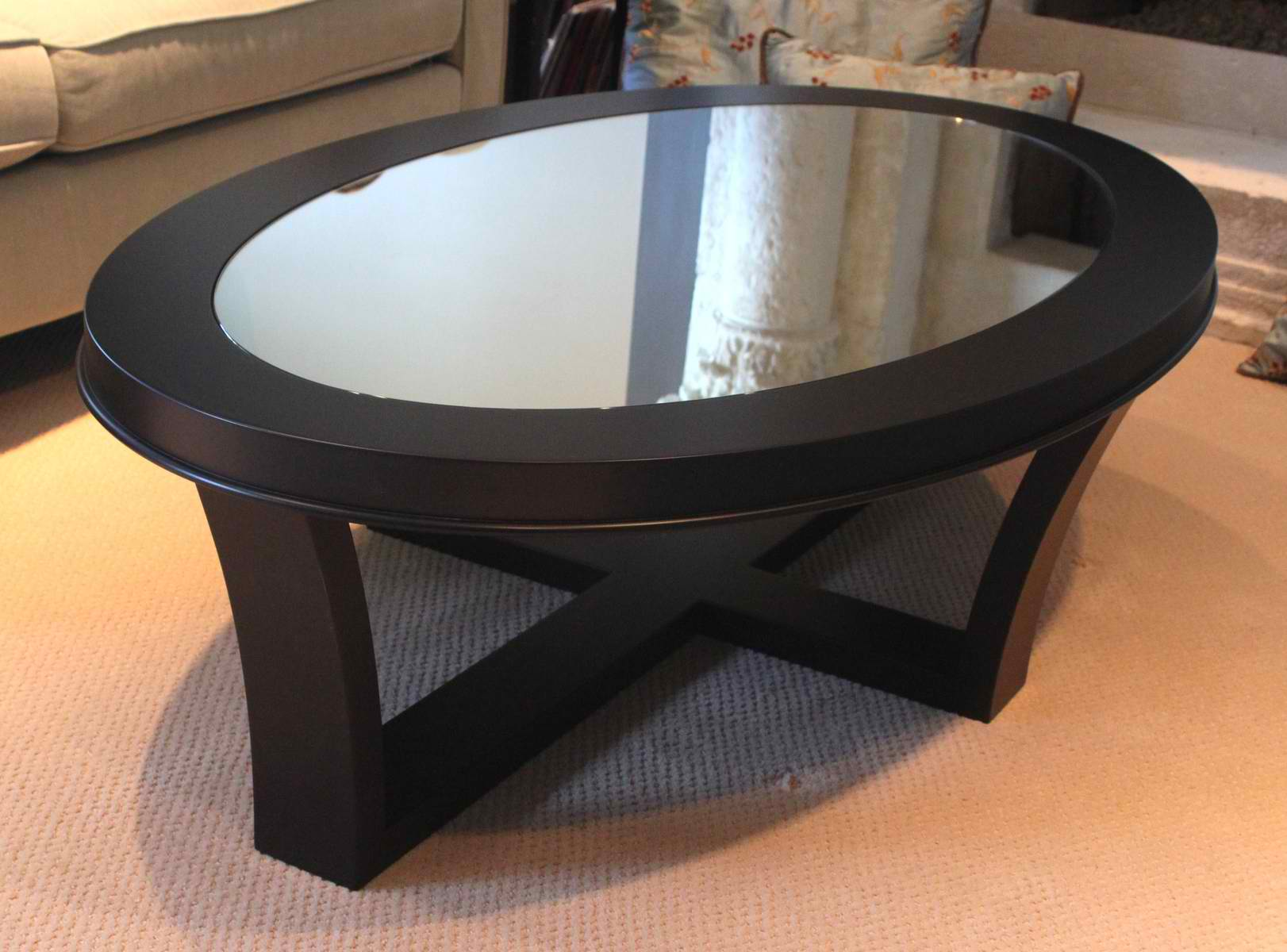 Glass Top Coffee Table With Storage Furniture Oval Glass Top Coffee Table With Storage And Wooden Base Frame Painted Black Color On Cream Carpet (Image 6 of 10)