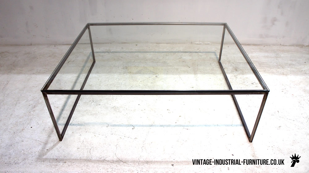Industrial Glass Coffee Table Pedrera Coffee Table 815 Dramatically Angled Black Steel Legs Make This Coffee Table Fascinating (View 3 of 9)
