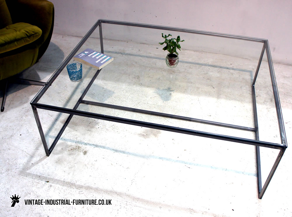 Industrial Glass Coffee Table Table Is A Series Of Low Glass Tables Created From A Sheet Of Glass Which Is Supported By A Continuous Metal Rod Frame (View 6 of 9)