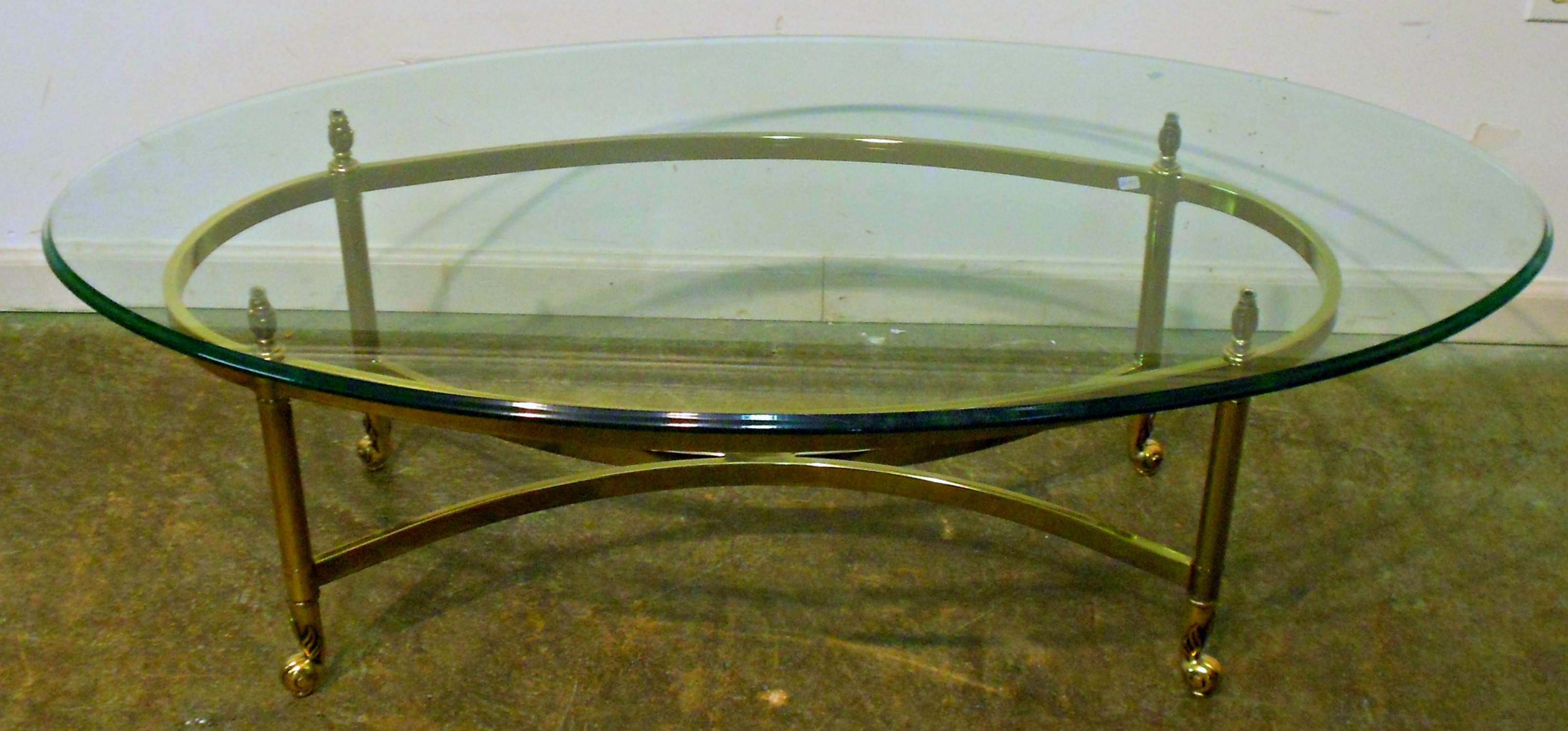 Oval Coffee Table Glass Top Furniture Oval Glass Top Coffee Table With Brass Frame And Wheels For Contemporary Living Room Spaces Ideas Wood (Image 2 of 10)