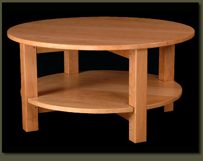 Solid Wood Round Coffee Table Our Loescher Round Coffee Table Is Solid Yet Elegant Its Lovely Curves And Wonderfully Practical Round Coffee Table With Round Tier Shelf (View 8 of 10)