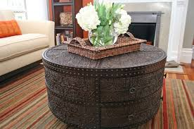 this-can-be-a-nice-concept-if-you-wish-to-convey-a-softer-attraction-to-your-seating-space-with-an-upholstered-look-espresso-round-coffee-table (Image 9 of 10)