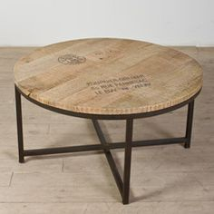 This Simplistic Table Has A Stamped And Scraped Surface Round Timber Coffee Table Foot Table From Brown Steel (Image 9 of 10)