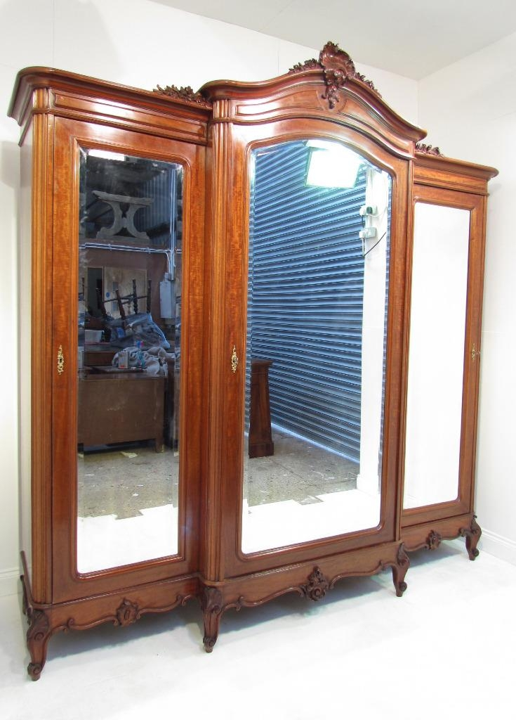 An Exceptional Large French Antique Mahogany Breakfront Wardrobe most certainly intended for Antique Breakfront Wardrobe (Image 19 of 30)