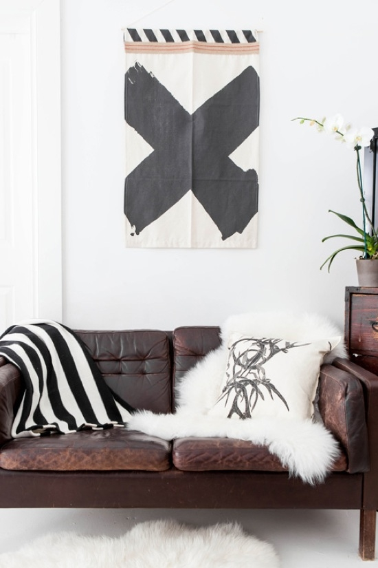 Black White Art Print Brown Leather Sofa Sheepskin Throws most certainly intended for Cheap Throws for Sofas (Image 5 of 20)