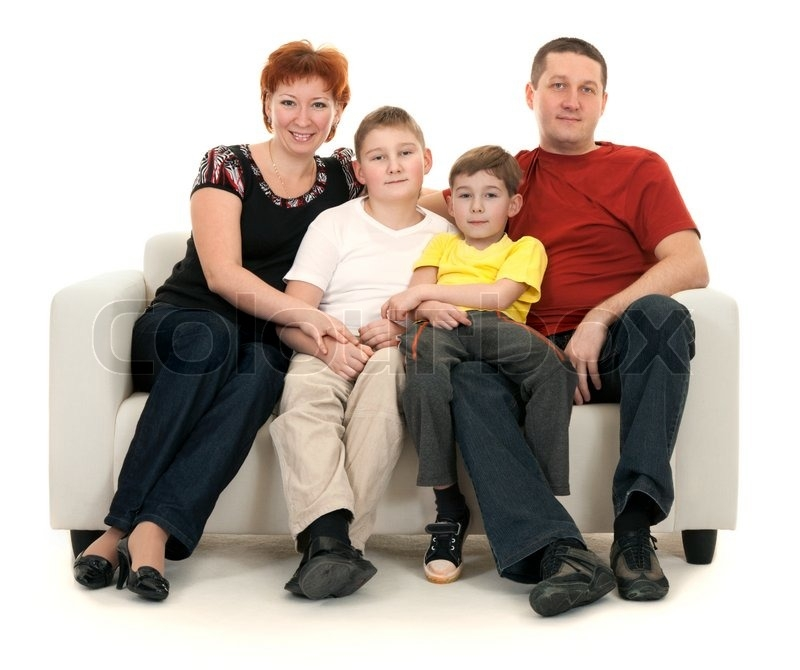 Family Of Four On A Sofa On A White Background Stock Photo well intended for Family Sofa (Image 7 of 20)