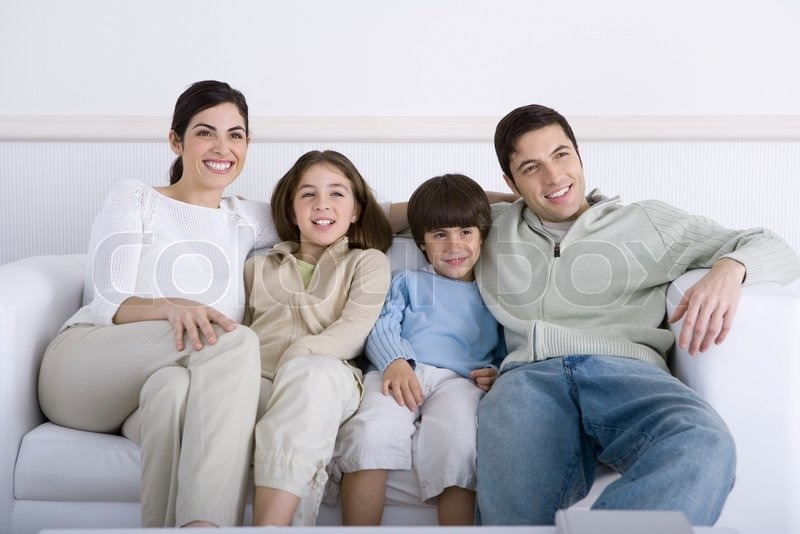 Family Sitting Together On Sofa Looking Away Stock Photo nicely intended for Family Sofa (Image 11 of 20)
