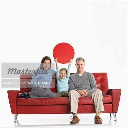 Portrait Of Family Sitting On Sofa With Daughter Holding Up Blank effectively for Family Sofa (Image 14 of 20)