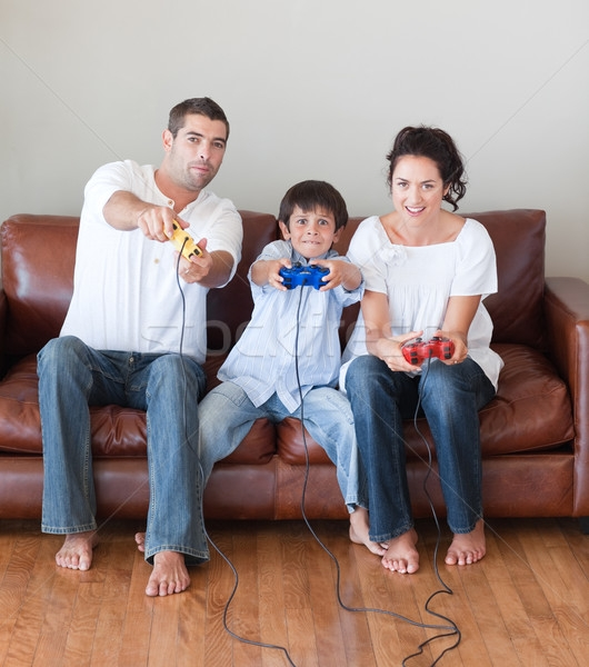Young Family On Sofa Playing Video Games Stock Photo Wavebreak Well Within Family Sofa (Gallery 12 of 20)
