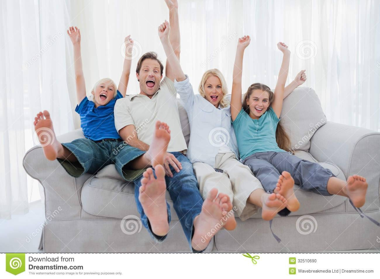 A Family Sitting On A Couch Royalty Free Stock Images - Image regarding Family Sofa (Image 1 of 30)