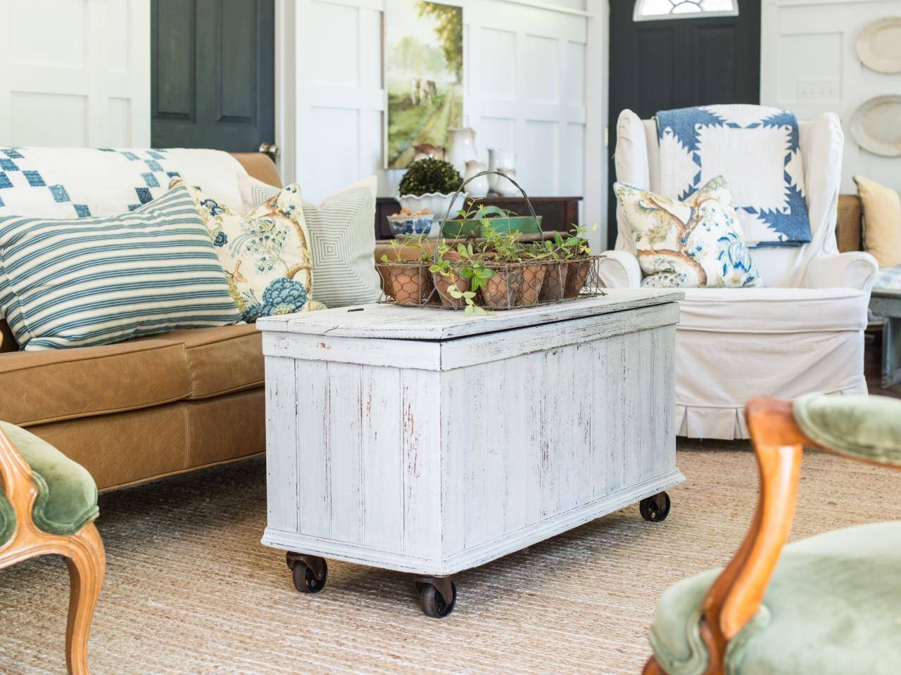 Add Casters To An Antique Trunk For A Mobile Coffee Table | Hgtv with Old Trunks As Coffee Tables (Image 2 of 30)