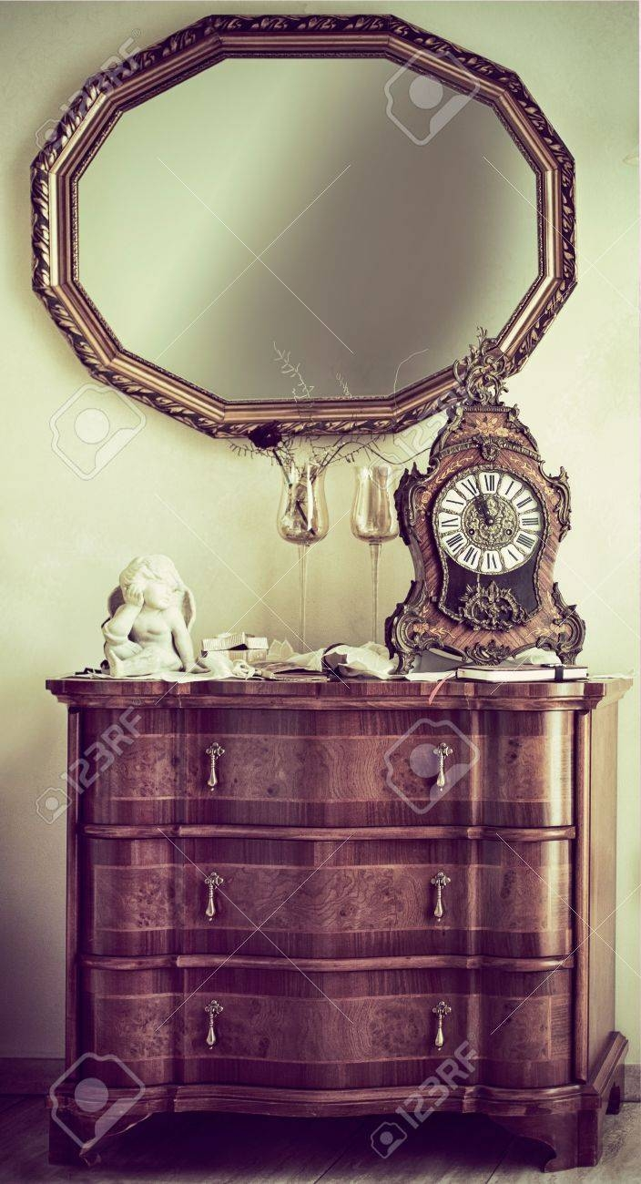 Antique Wooden Commode With A Baroque Style Ornate Mantel Clock regarding Antique Style Wall Mirrors (Image 6 of 25)