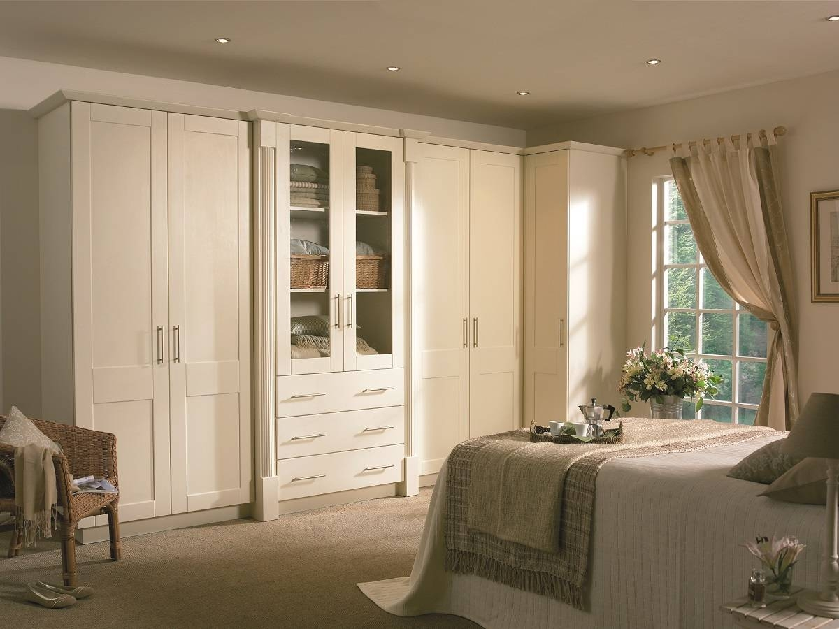 Bedroom : A Modern Bedroom Double Bed Wooden Table Below Window Within Fitted Wooden Wardrobes (View 29 of 30)