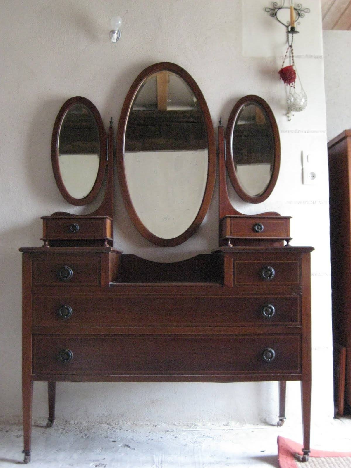 Brown Wooden Vanity With Drawers Combined With Triple Oval Mirrors with Triple Oval Mirrors (Image 4 of 25)