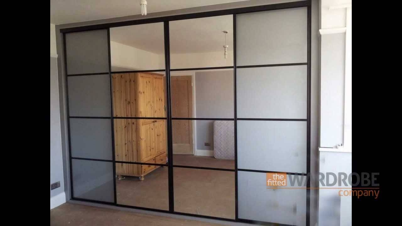 Built In Sliding Door Wardrobe | Pure White Glass | Black Frame inside Dark Wood Wardrobe Sliding Doors (Image 9 of 30)
