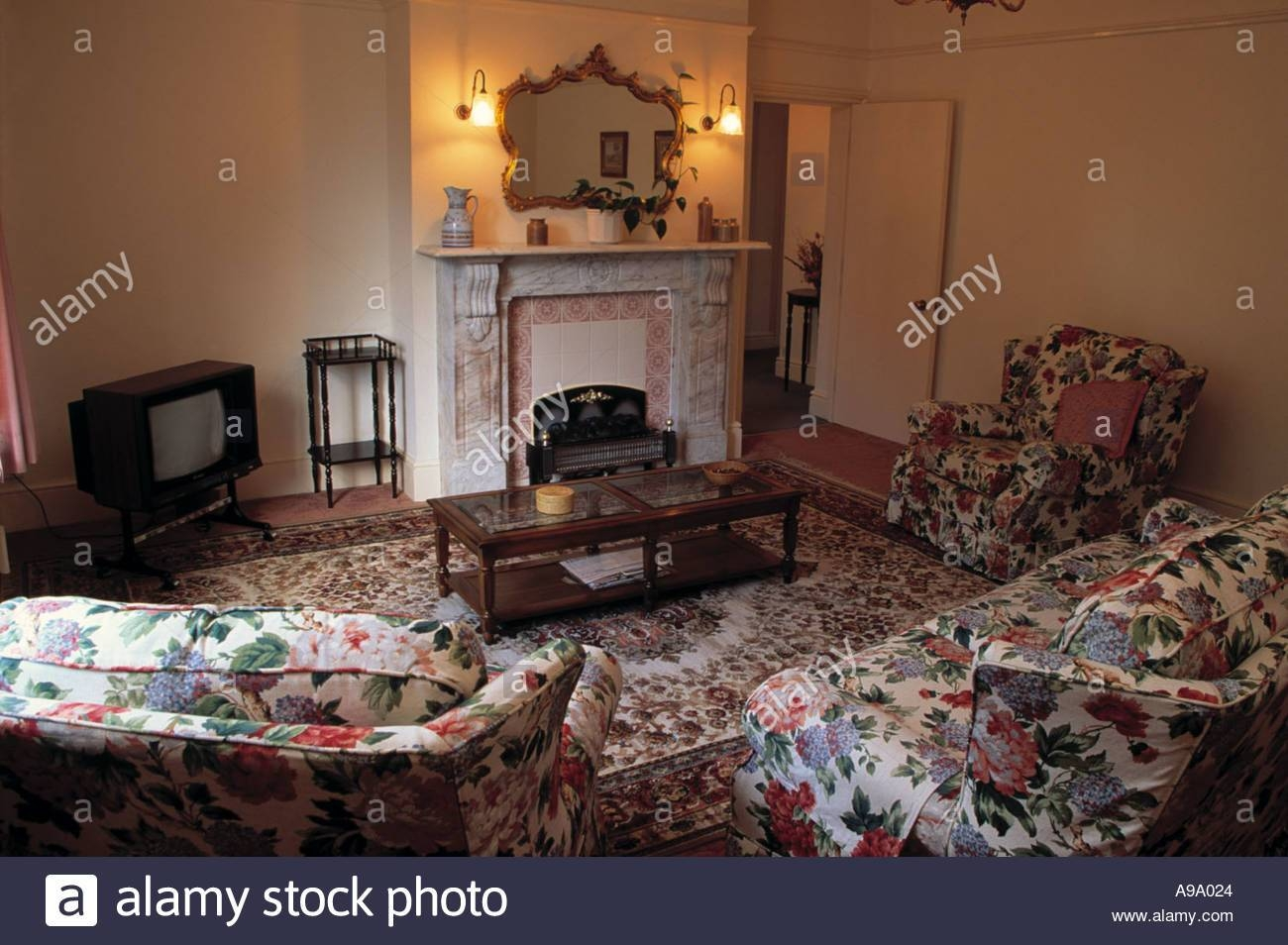 Chintz Sofa And Armchairs In Dated Living Room With Television In with regard to Chintz Floral Sofas (Image 17 of 30)