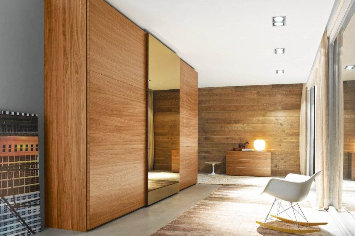 Create A New Look For Your Room With These Closet Door Ideas with Dark Wood Wardrobe Sliding Doors (Image 10 of 30)