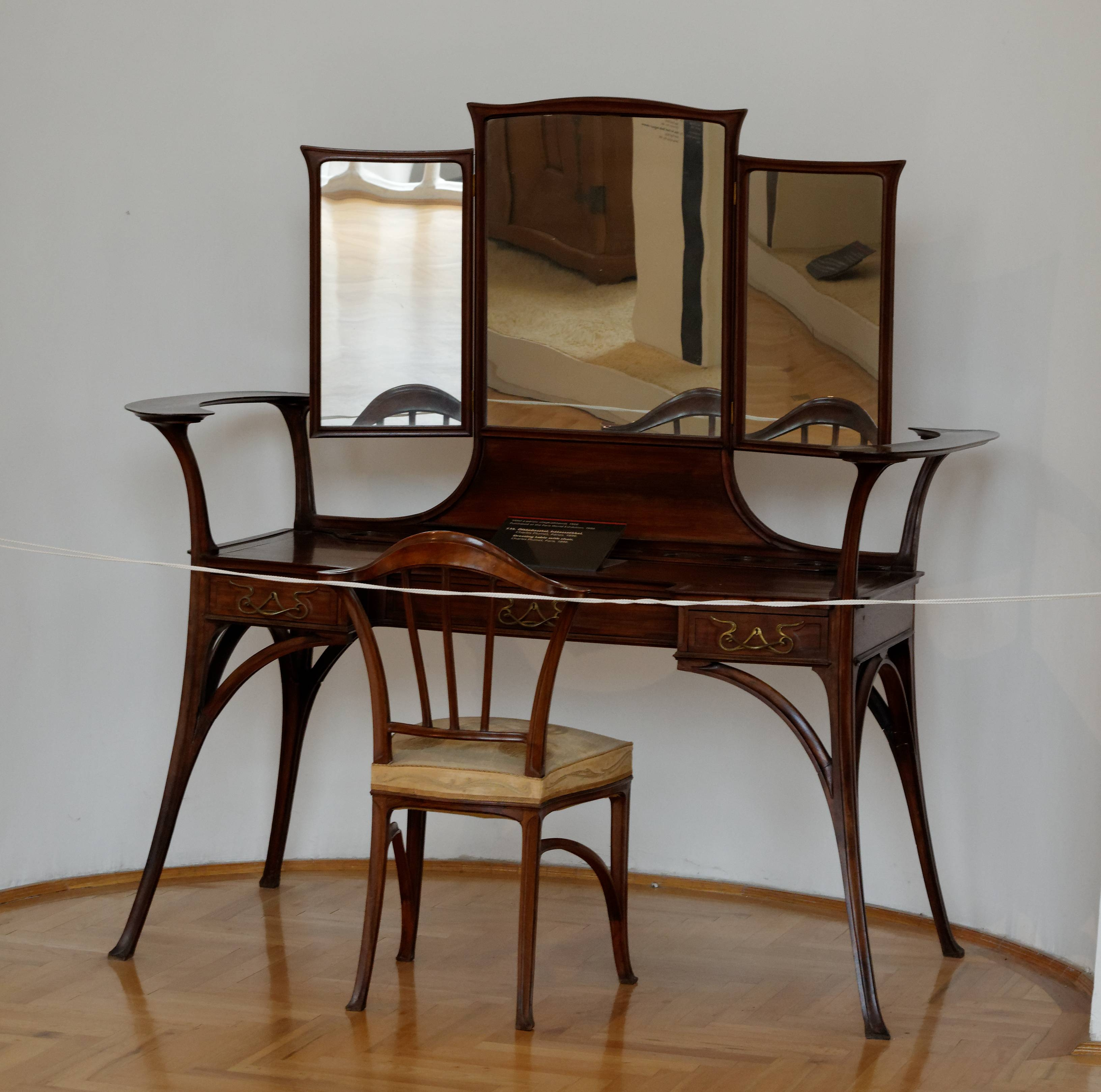 Dark Brown Wooden Dressing Table Having Drawer And Black Knob On inside Triple Oval Mirrors (Image 5 of 25)