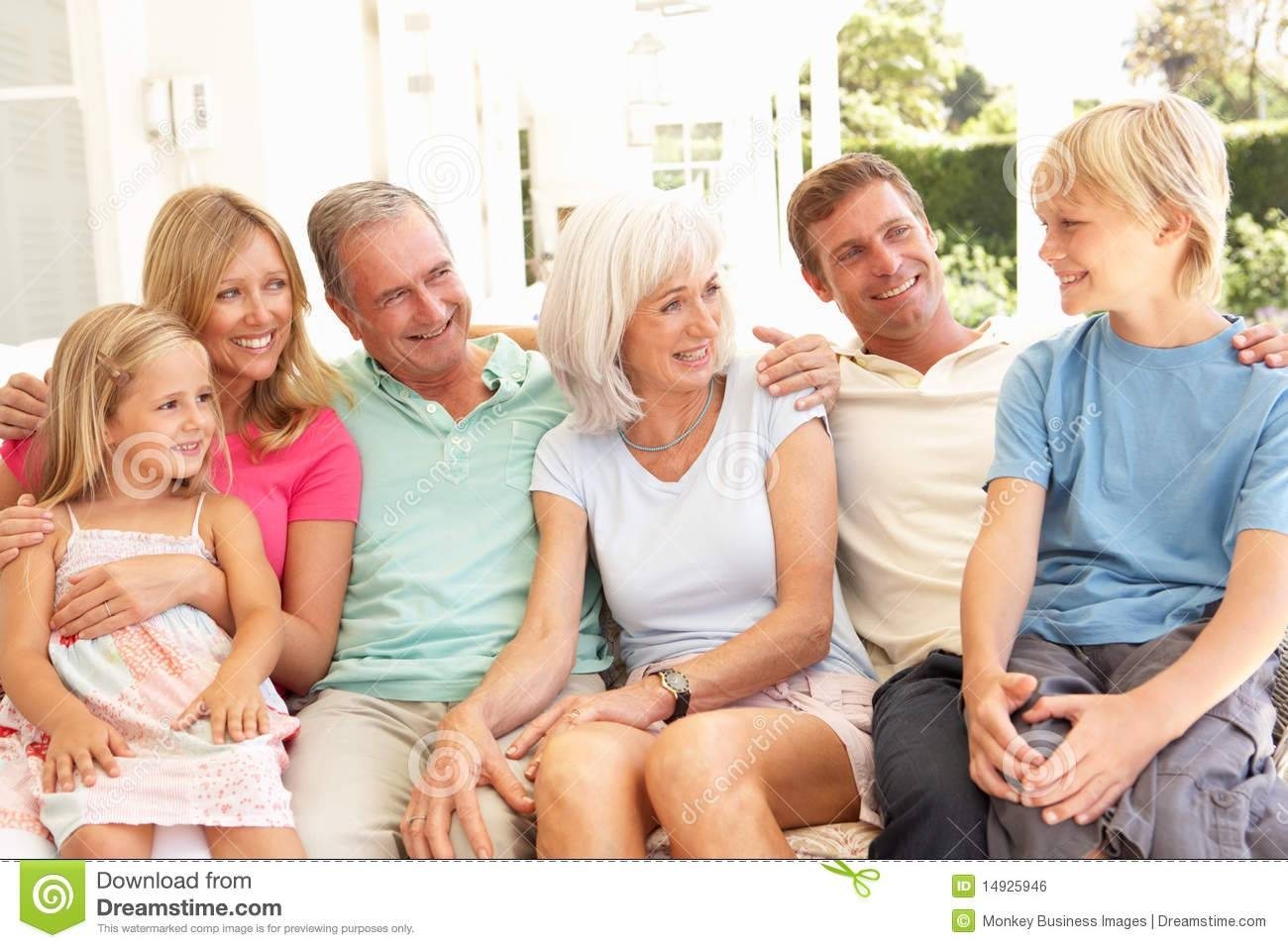Extended Family Relaxing Together On Sofa Royalty Free Stock Image within Family Sofa (Image 4 of 30)