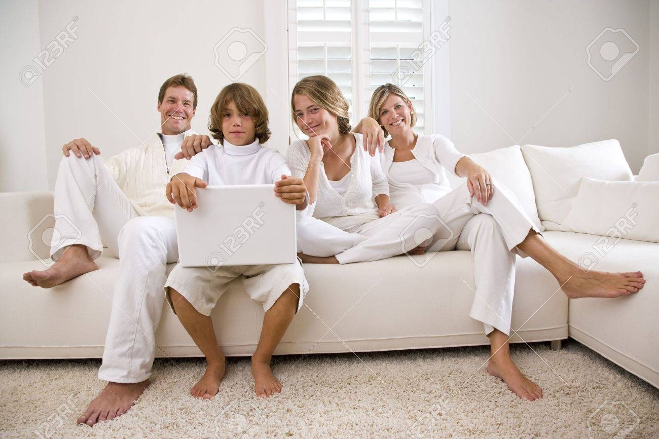 Family Relaxing On White Sofa With Laptop Stock Photo, Picture And regarding Family Sofa (Image 7 of 30)