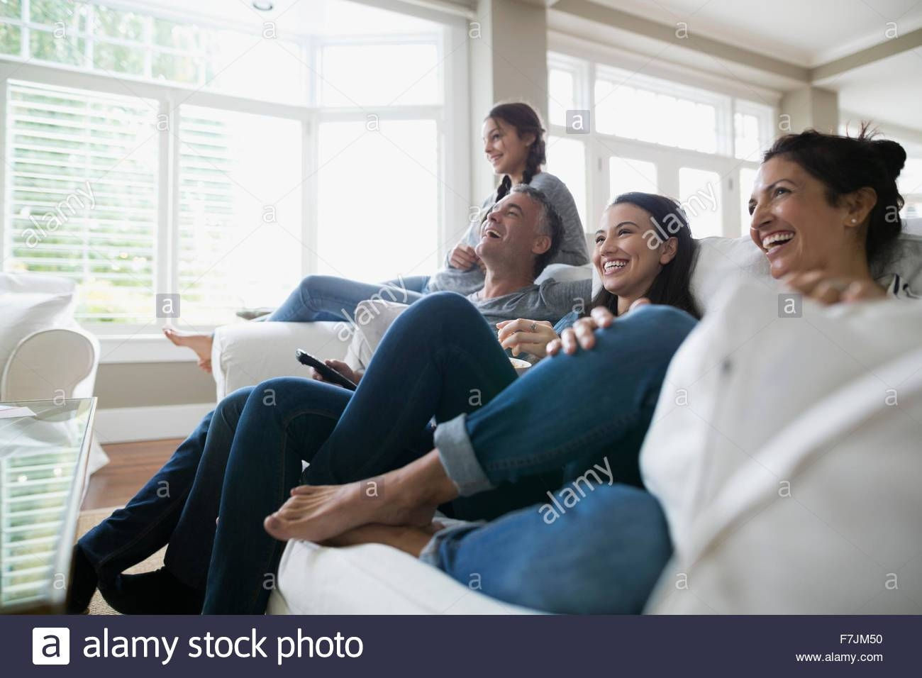 Family Sitting On Sofa Stock Photos & Family Sitting On Sofa Stock intended for Family Sofa (Image 9 of 30)