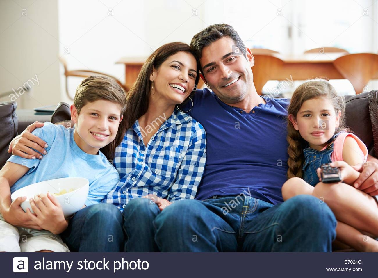 Family Sitting On Sofa Stock Photos & Family Sitting On Sofa Stock with regard to Family Sofa (Image 10 of 30)