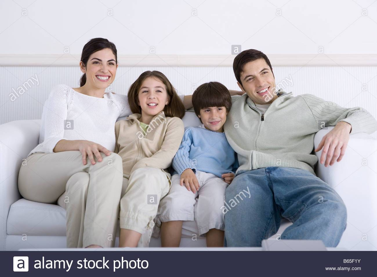 Family Sitting Together On Sofa, Looking Away Stock Photo, Royalty for Family Sofa (Image 11 of 30)