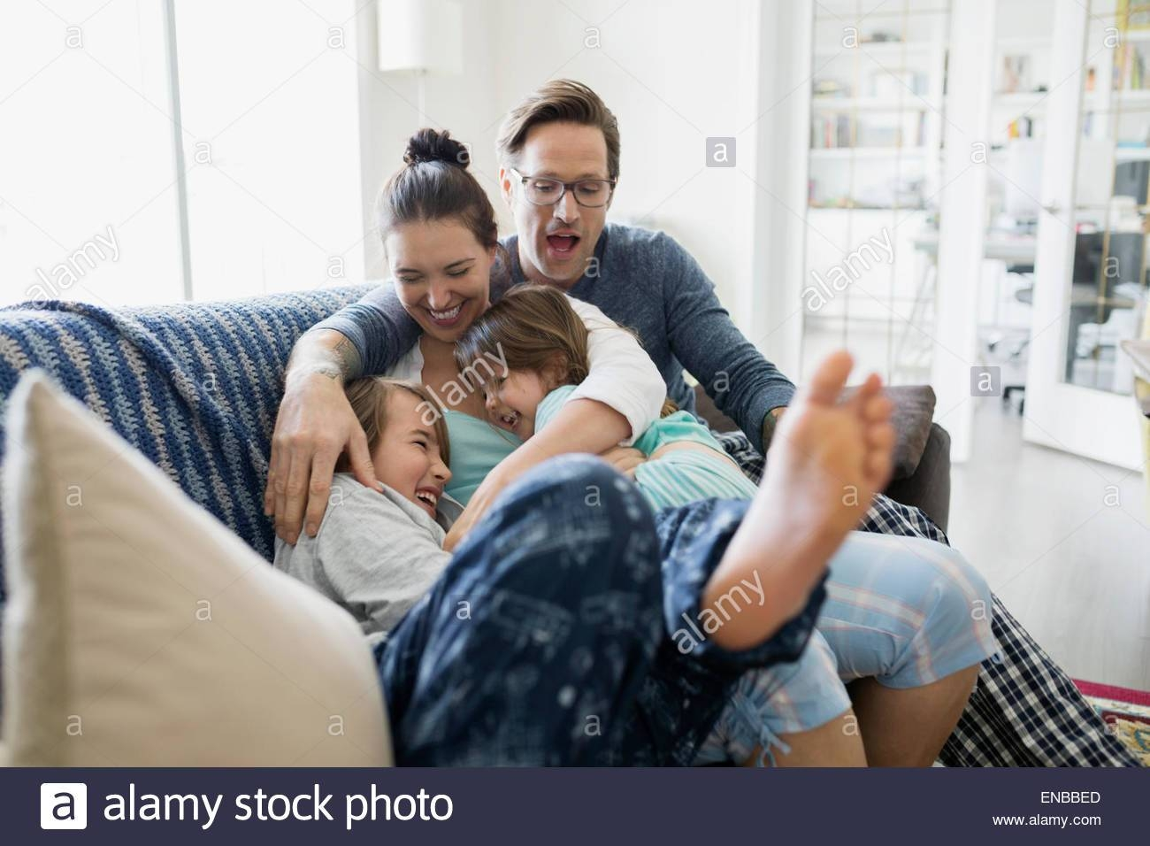 Family Sitting Together On Sofa, Looking Away Stock Photo, Royalty with Family Sofa (Image 12 of 30)