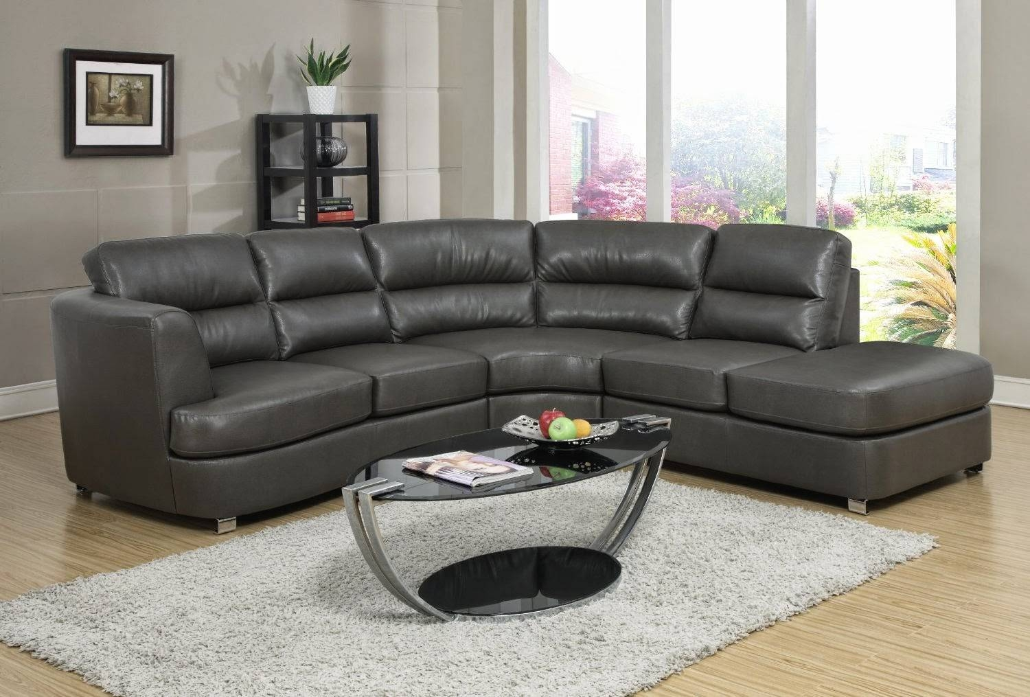 Furniture. Black Leather Sectional Sofa And Ottoman Coffe Table On intended for Oval Sofas (Image 5 of 30)