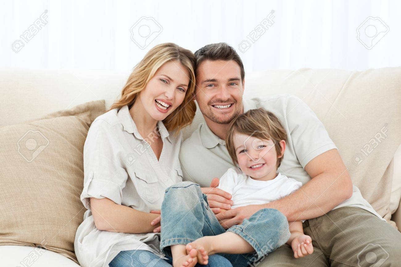 Happy Family On Their Sofa Stock Photo, Picture And Royalty Free with regard to Family Sofa (Image 23 of 30)