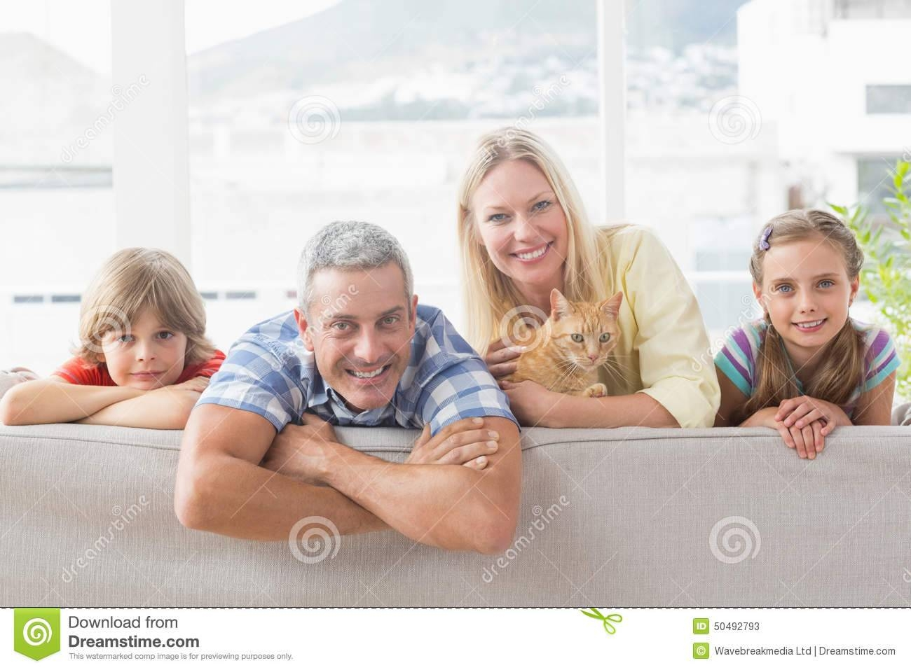 Happy Family With Cat On Sofa At Home Stock Photo - Image: 50492793 in Family Sofa (Image 26 of 30)