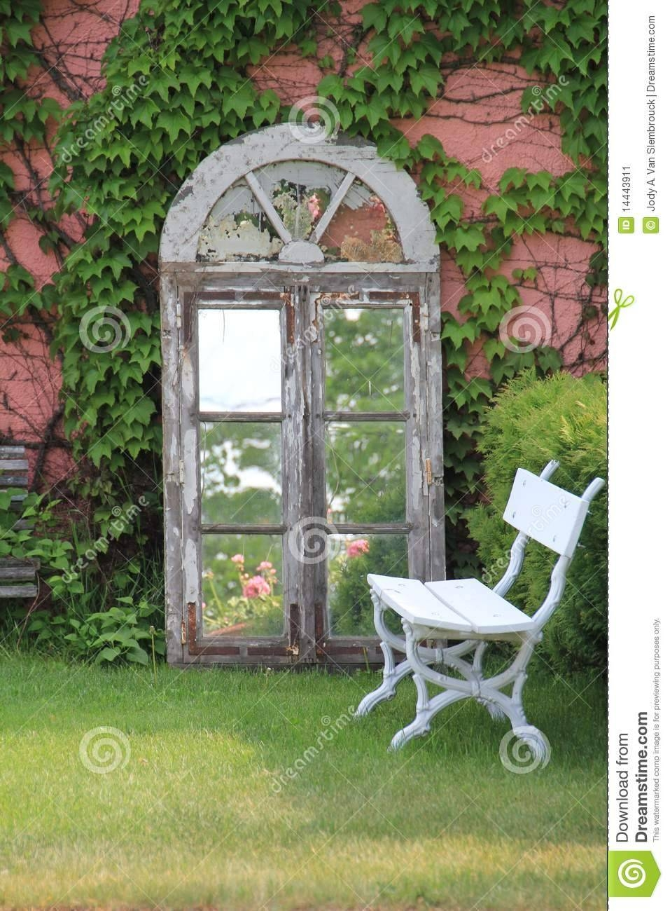 Ivy Covered Wall With Mirror And Bench Stock Image - Image: 14443911 inside Garden Wall Mirrors (Image 21 of 25)