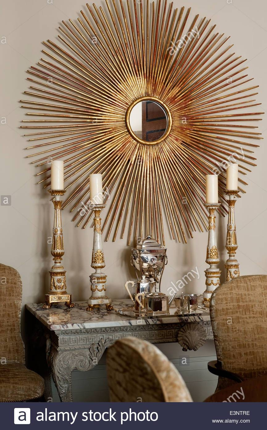 Large Gilt Sunburst Mirror On Wall Above Marble Topped Side Table pertaining to Large Sunburst Mirrors (Image 13 of 25)