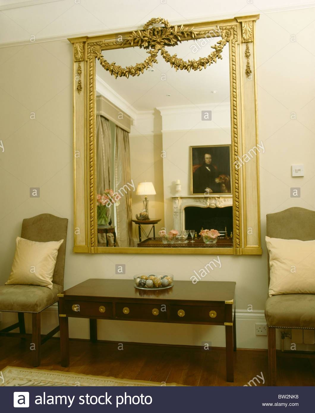 Large Ornate Gilt Antique Mirror On Wall Above Console Table In pertaining to Large Antiqued Mirrors (Image 19 of 25)