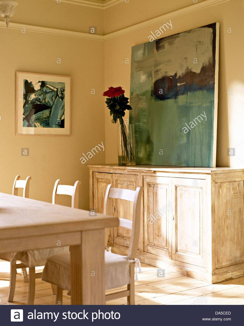 Large Painting On Distressed Wood Sideboard In Neutral Dining Room intended for Distressed Wood Sideboards (Image 20 of 30)
