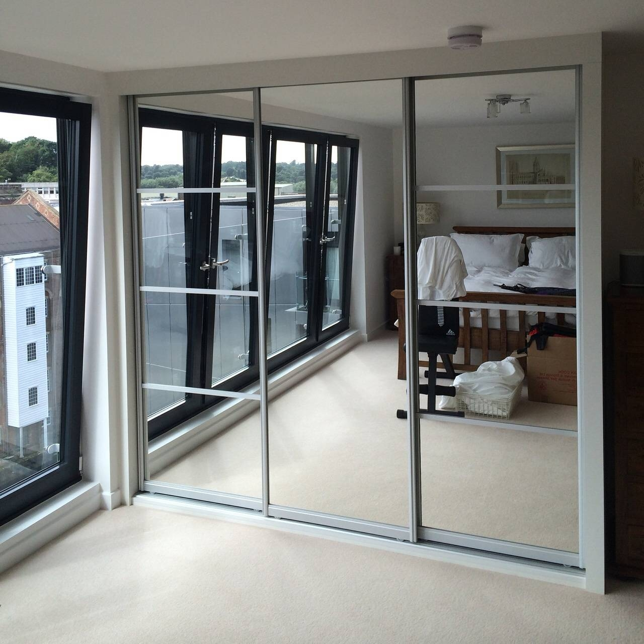 Mirrored Wardrobes: Bring Light And Space To Your Bedroom with Mirrored Wardrobes (Image 10 of 15)