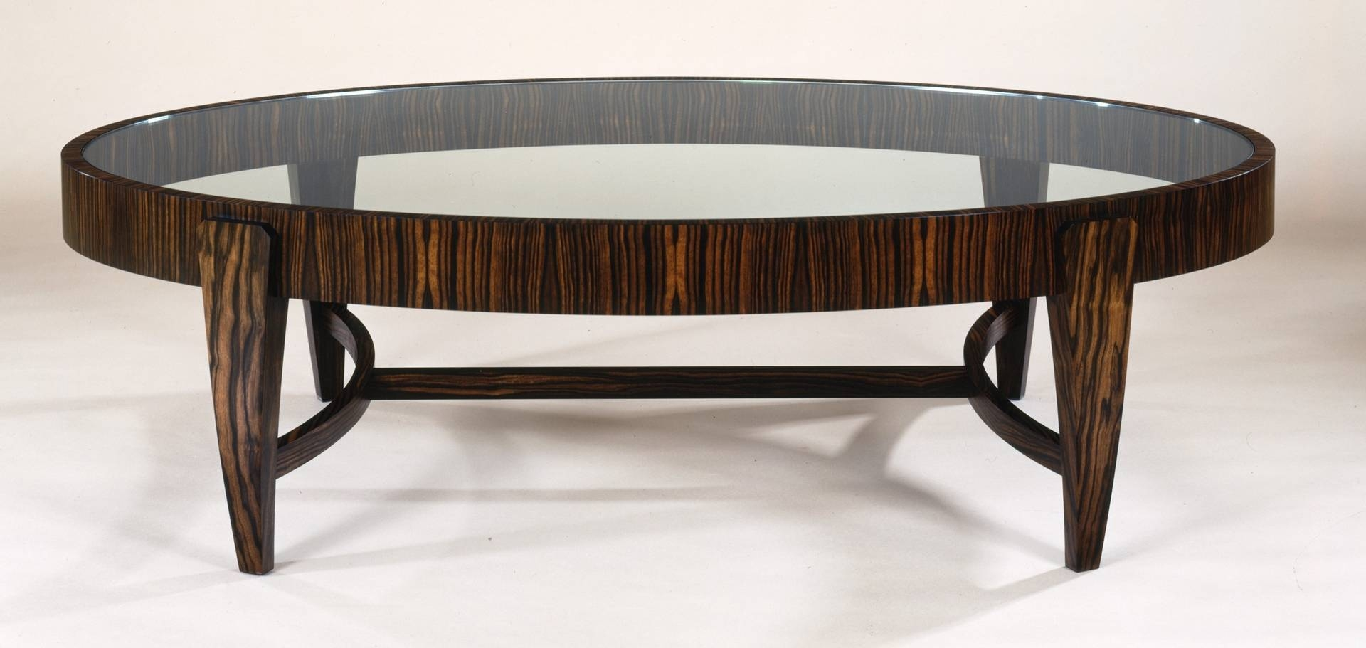 Oval Glass Top Coffee Table With Wooden Legs And Laminate Frame with regard to Oval Mirrored Coffee Tables (Image 22 of 30)