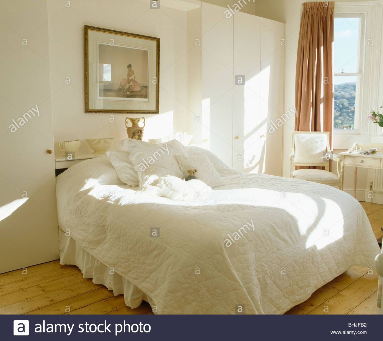 Picture On Wall Above Bed With White Quilt In White Country intended for Wardrobes Above Bed (Image 12 of 15)