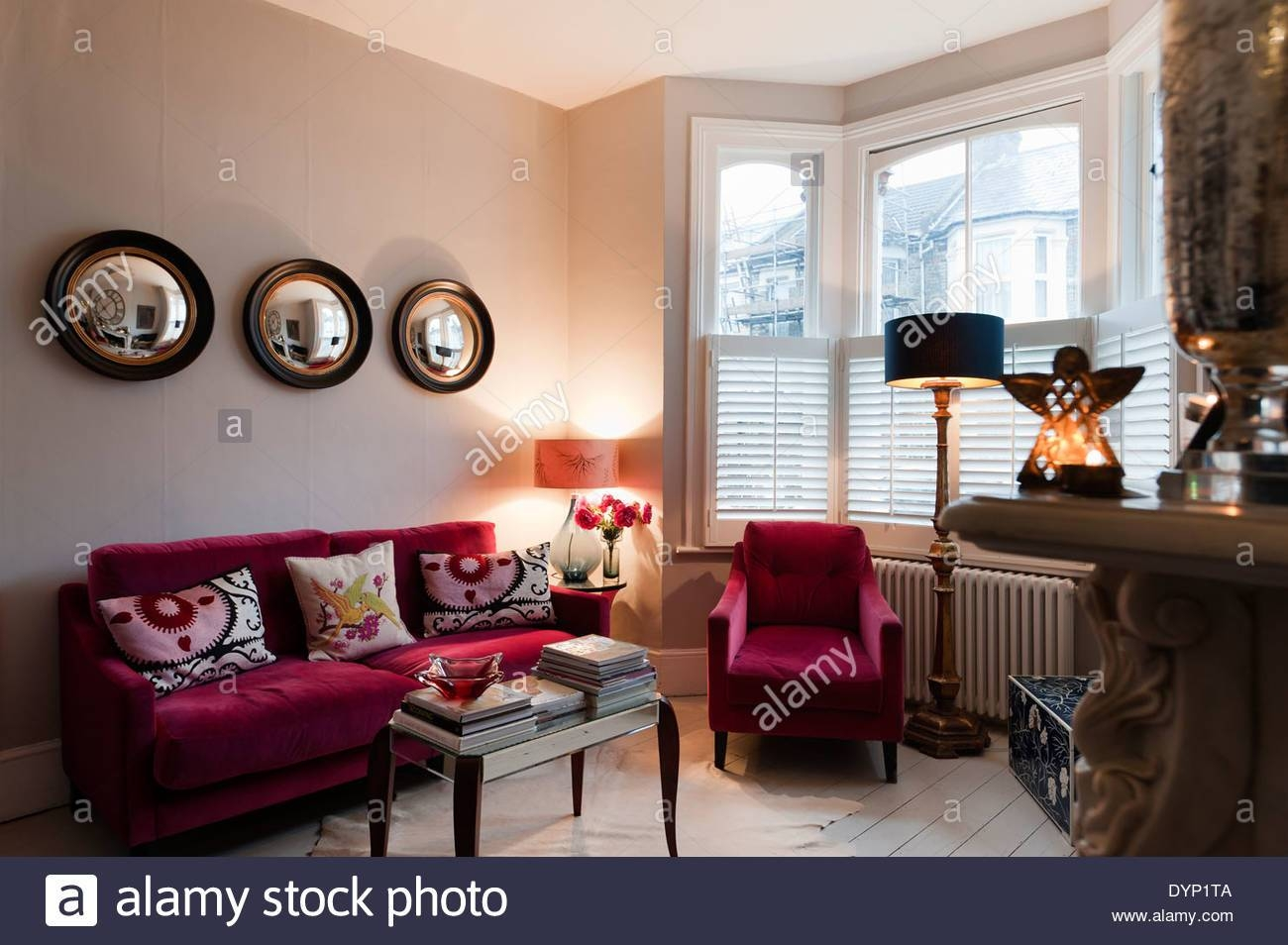 Raspberry Coloured Velvet Furniture In Living Room With Graham And for Porthole Wall Mirrors (Image 20 of 25)