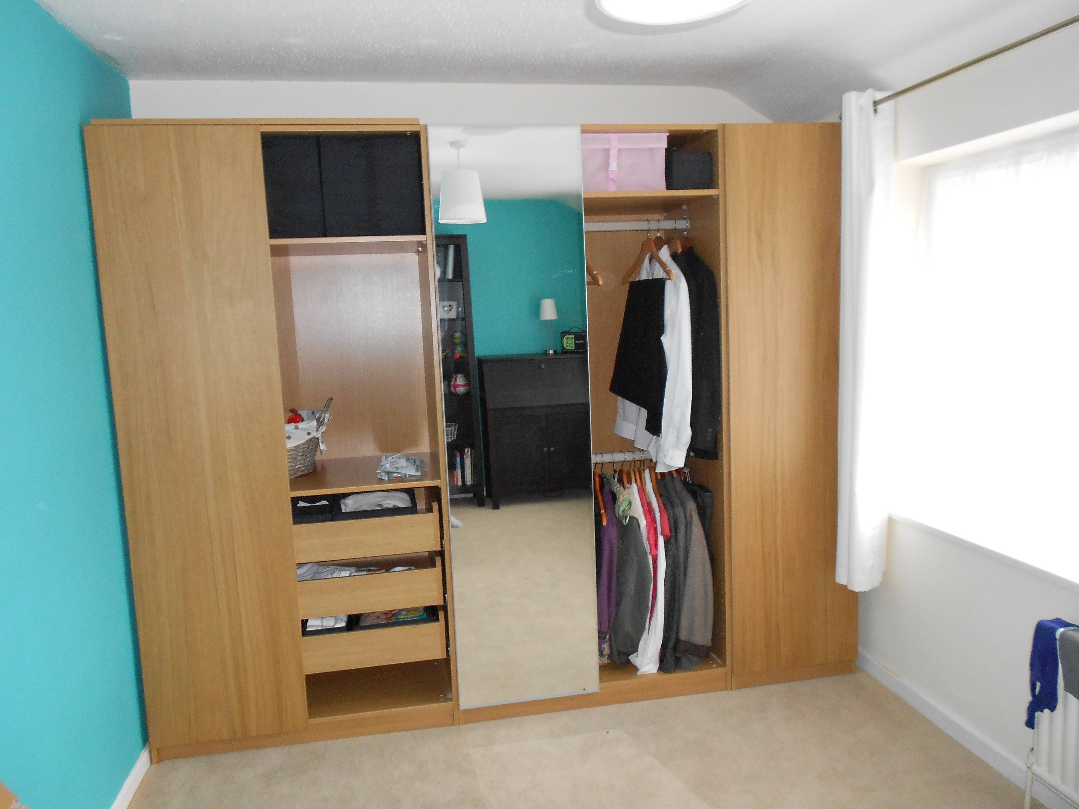 Rectangle White Wooden Wardrobe With Shelf And White Pole And inside Wardrobes With Shelves And Drawers (Image 21 of 30)
