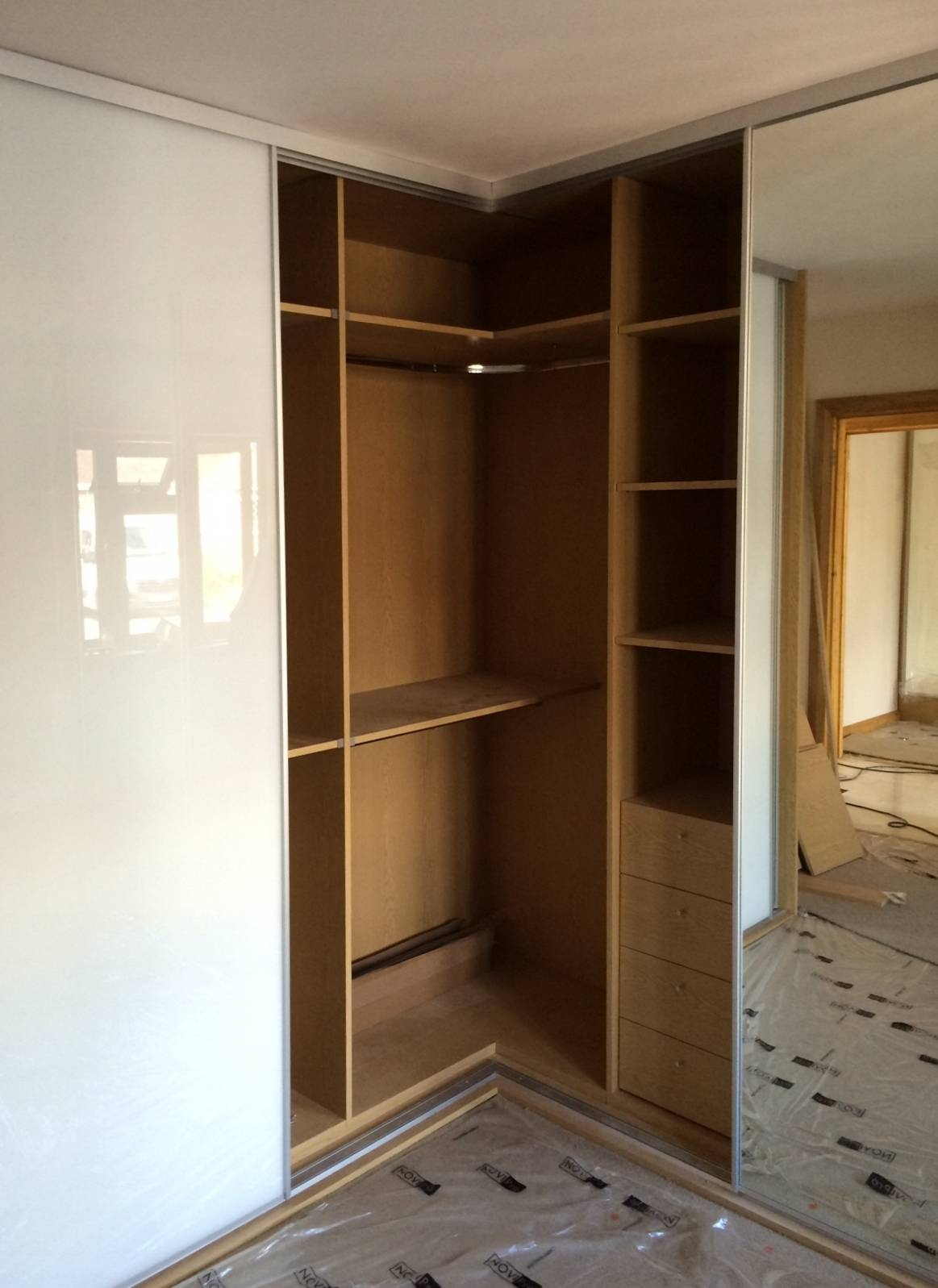 Sliding Wardrobe Doors And Wardrobe Interiors | Corner & L Shaped inside Curved Corner Wardrobe Doors (Image 29 of 30)
