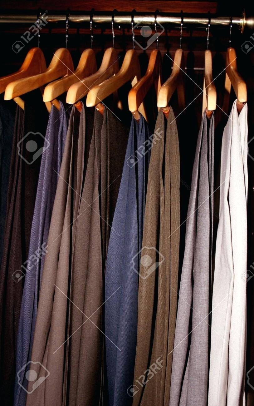 Stock Photo Mens Dress Slacks Hanging In A Dark Wood Wardrobe intended for Dark Wood Wardrobe Closet (Image 22 of 30)