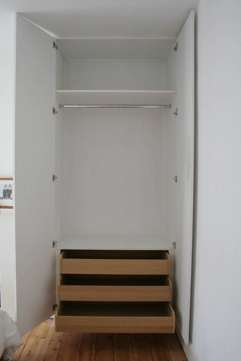 Triple White Wooden Drawers Combined With Shelves Also Pole For regarding Wardrobes With Drawers And Shelves (Image 20 of 30)