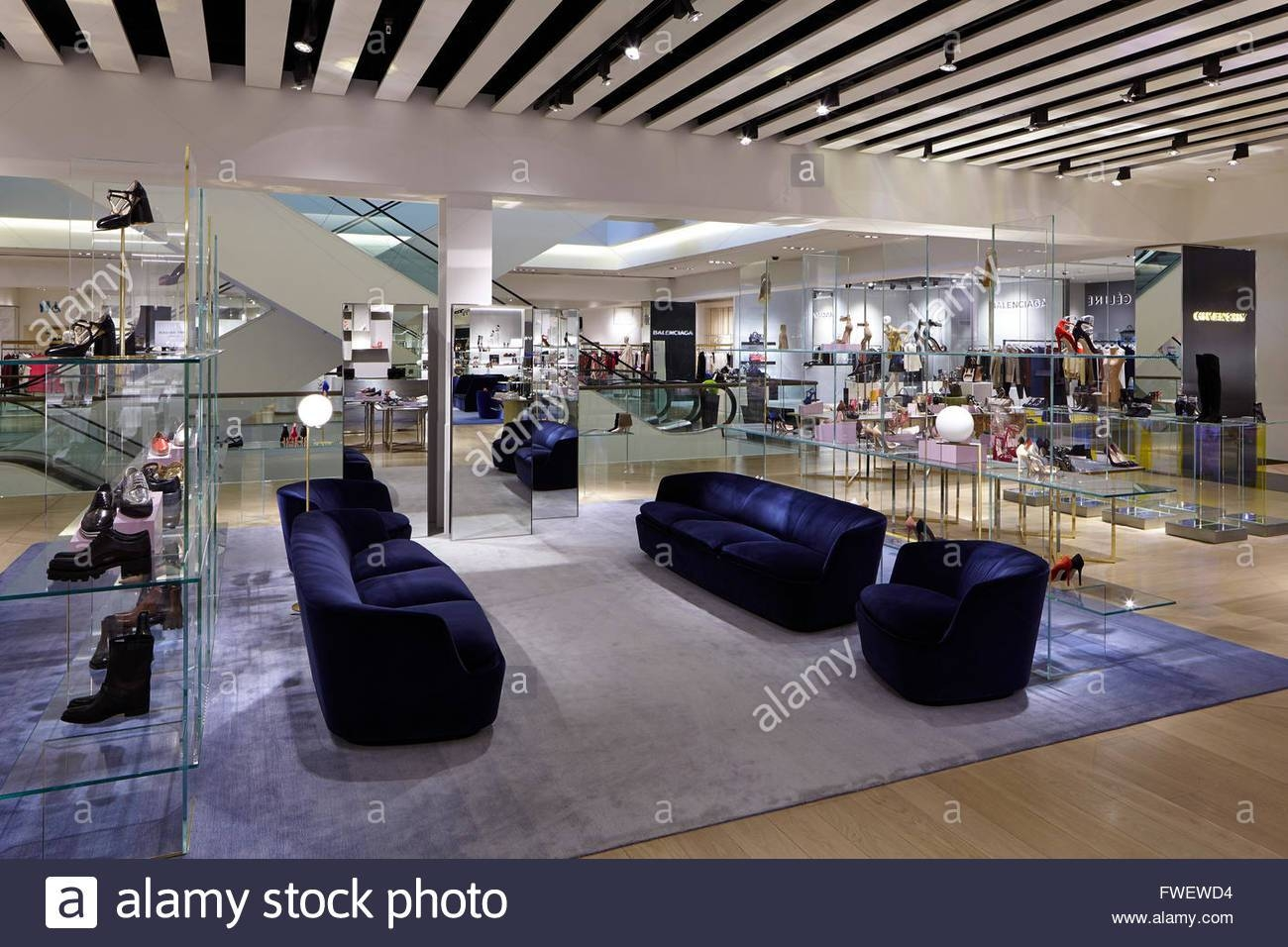 Wide Shot Of The Floor With Shoes On Display And Blue Velvet Sofas inside Manchester Sofas (Image 30 of 30)