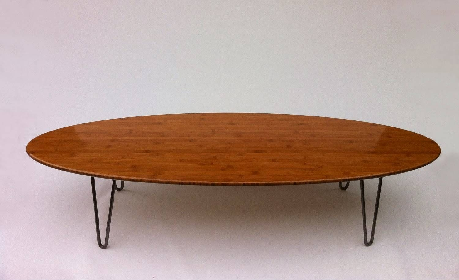 25 Elegant Oval Coffee Table Designs Made Of Glass And Wood throughout Metal Oval Coffee Tables (Image 1 of 15)