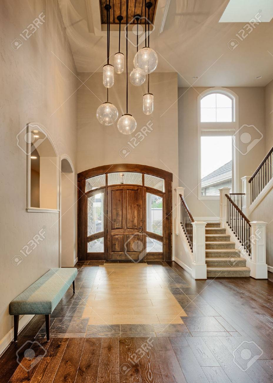 Beautiful Foyer In Home; Entryway With Stairs, Pendant Lights throughout Vaulted Ceiling Pendant Lighting (Image 1 of 15)
