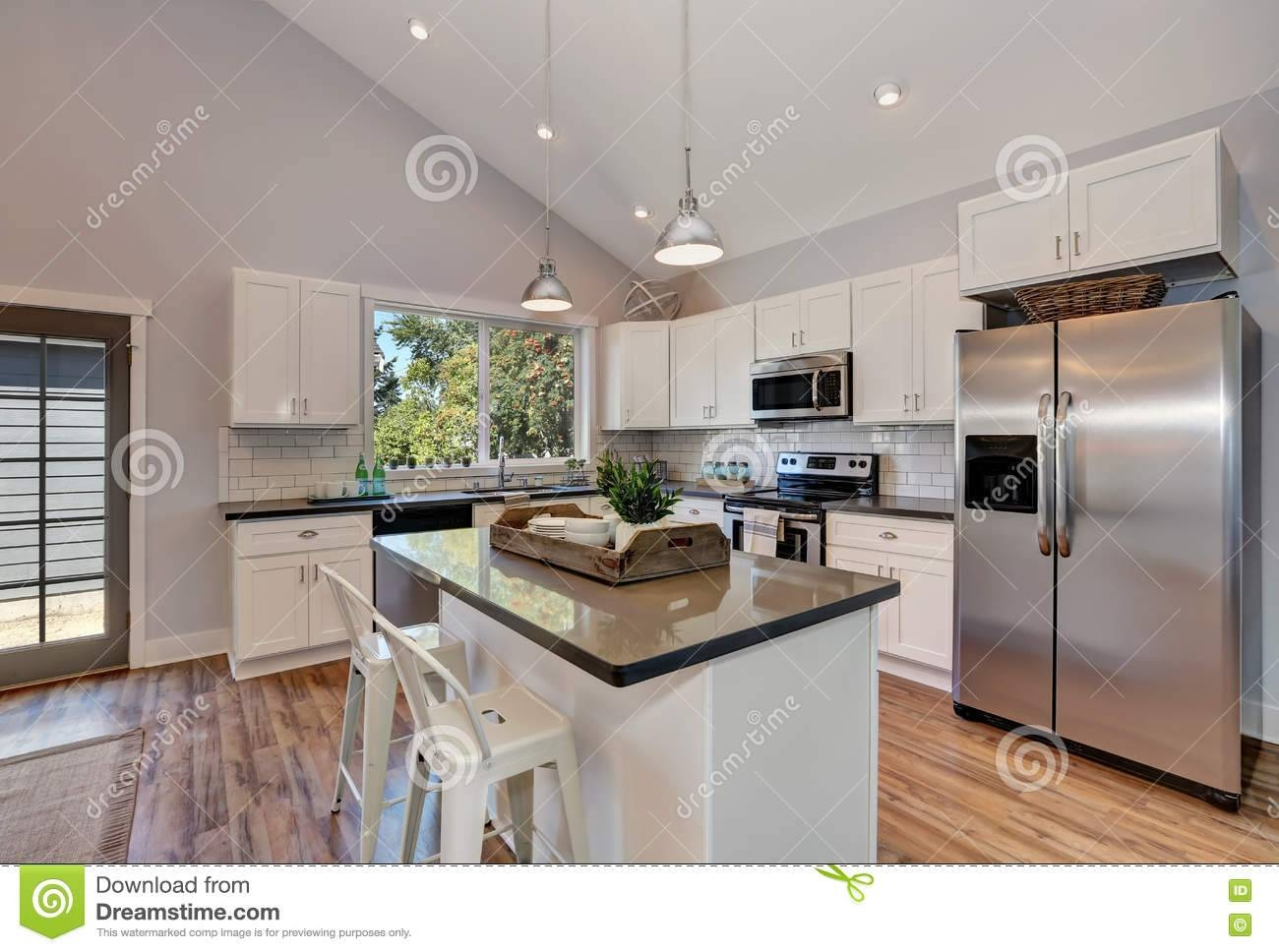 Interior Of Kitchen Room With High Vaulted Ceiling. Stock Photo throughout Vaulted Ceiling Pendant Lighting (Image 8 of 15)