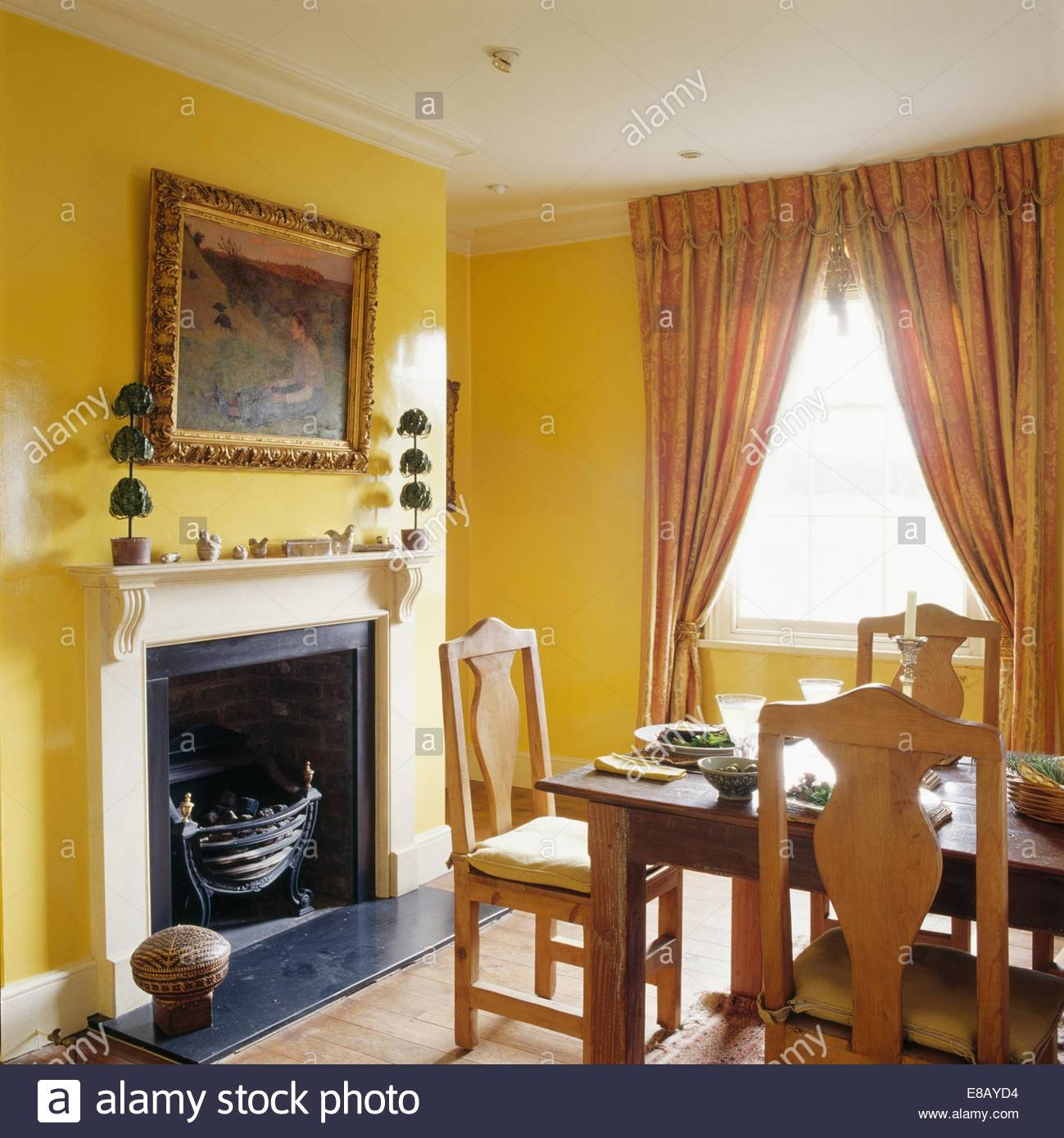 Large Gilt-Framed Mirror Above Fireplace In Yellow Dining Room throughout Large Gilt Framed Mirrors (Image 4 of 15)