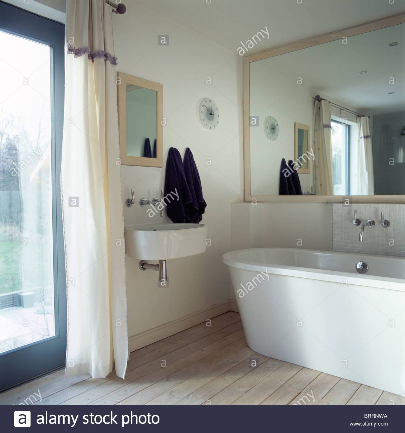Large Mirror Above Modern Bath In Small Modern Bathroom With Stock Within Modern Large Mirrors (View 10 of 15)